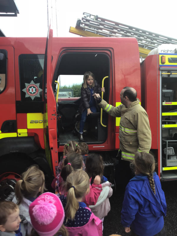 Everyone got to climb onto a fire engine to see inside.