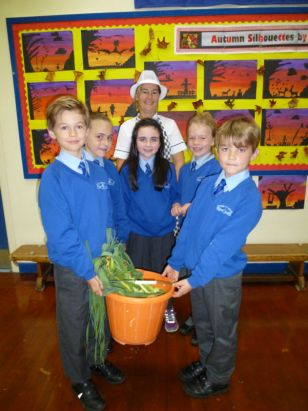 Eco Club hands home grown vegetables to school canteen